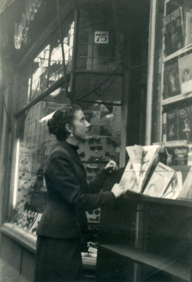 Isabelle Stoughton outside 75 Charing Cross Road, c1954.<br />© Dance Books. (Click image for larger version)