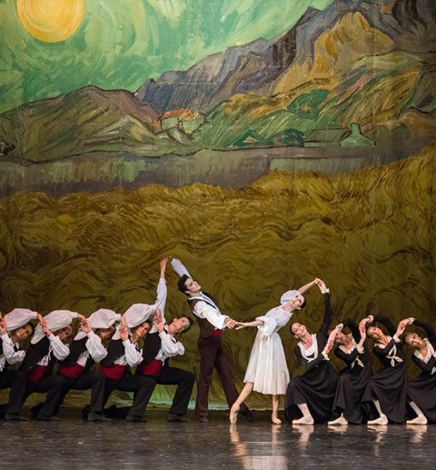 Isabelle Ciaravola as Vivette and Jeremie Belingard as Frederi, with members of Paris Opera Ballet in Roland Petit's <I>L'Arlesienne</I>.<br />© Stephanie Berger. (Click image for larger version)