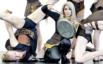 Evelyn Glennie, surrounded by Marc Brew Company, in Fusional Fragments costumes.© Irven Lewis. (Click image for larger version)