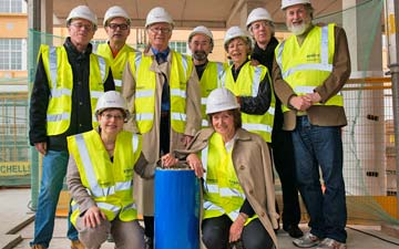 Rambert Dance Company's Artistic Director, Mark Baldwin, joined by former Artistic Directors or their representatives, to bury time capsule at Rambert's new headquarters on the South Bank. Back L-R: Tim Ellis, Mark Baldwin – Artistic Director, John Chesworth, Christopher Bruce, Val Bourne, Robert North and Richard Alston. Front L-R: Matilda Ellis and Prue Skene.© Simon Weir. (Click image for larger version)