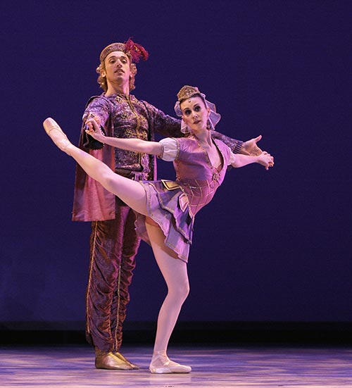 "Elisabeth Holowchuk and Matthew Prescott in <I>Pas de Deux Mauresque</I> from Balanchine's <I>Don Quixote</I> (<a href=""http://www.ballet.co.uk/magazines/yr_08/nov08/ok_rev_suzanne_farrell_balanchine_1008.htm"">from 2008 Balletco review</a>). © Carol Pratt"