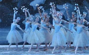 The snowflakes in George Balanchine's The Nutcracker.© Paul Kolnik. (Click image for larger version)