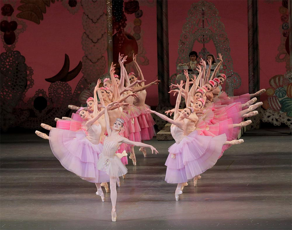 Tiler Peck, as Dewdrop, with flowers in <I>The Nutcracker</I>.<br />© Paul Kolnik. (Click image for larger version)