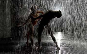 Wayne McGregor | Random Dance perform in the Rain Room.© Ravi Deepres & Alicia Clarke. Rain Room, Random International 2012. Courtesy of Barbican Art Gallery.