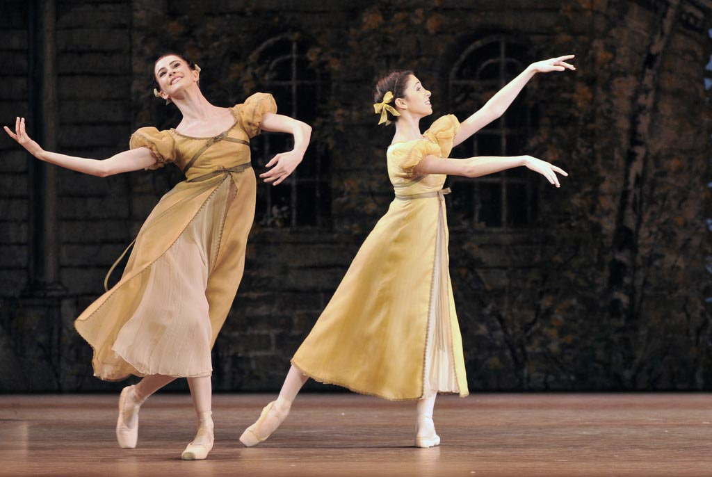 Olivia Cowley & Yasmine Naghdi as village girls in <I>Onegin</I>.<br />© Dave Morgan, by kind permission of the Royal Opera House. (Click image for larger version)