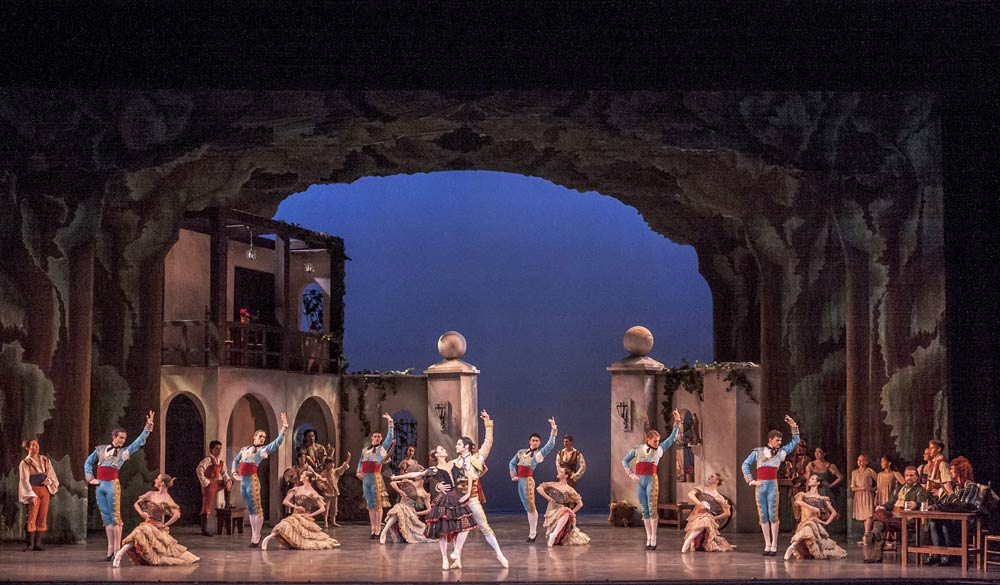 Full stage shot of the courtyard in <I>Don Quixote</I>.<br />© Robert Shomler. (Click image for larger version)