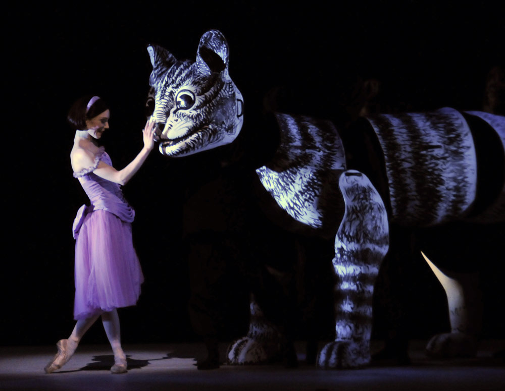 Sarah Lamb and the Cheshire Cat in <I>Alice's Adventures in Wonderland</I>.<br />© Dave Morgan, by kind permission of the Royal Opera House. (Click image for larger version)