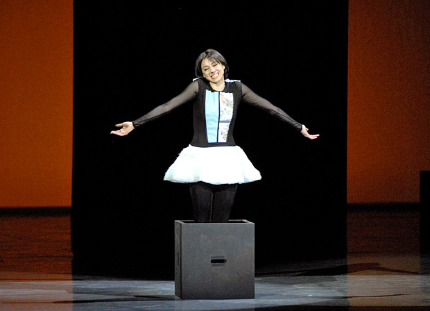"Nina Ananiashvili with her final shrug in <I>Tampopo</I>, from <a href=""https://dancetabs.com/2012/04/nina-ananiashvili-30-years-on-stage-gala-tbilisi/"">2012 gala</a>.<br />© Lado Vachnadze. (Click image for larger version)"