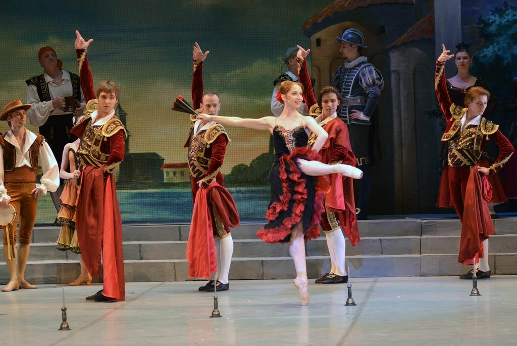 Valeria Zapasnikova (Street Dancer) and Toreadors in <I>Don Quixote</I>.<br />© Dave Morgan. (Click image for larger version)