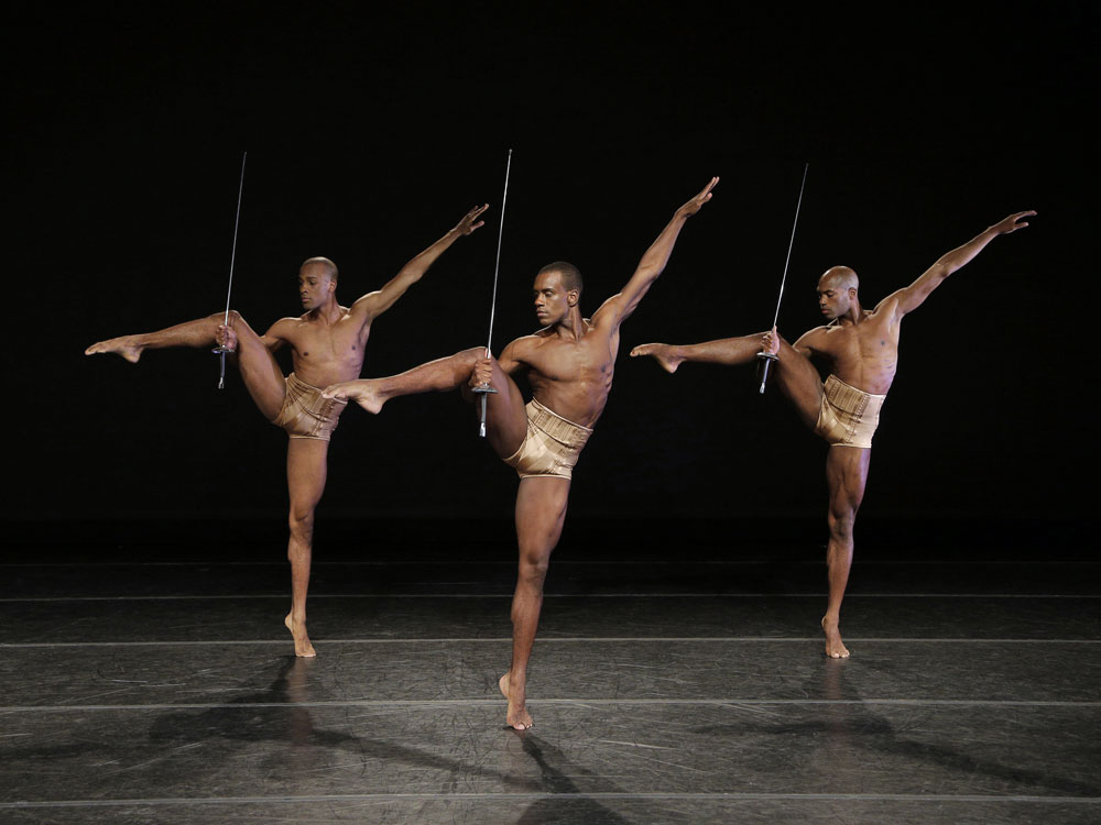 Yannick Lebrun, Kirven James Boyd and Antonio Douthit in <I>Petite Mort</I>.<br />© Paul Kolnik. (Click image for larger version)