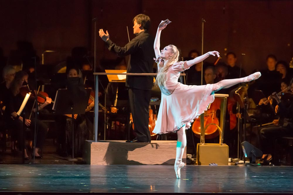 Sara Mearns in Le Baiser de la Fée (with Alan Gilbert behind).© Chris Lee. (Click image for larger version)