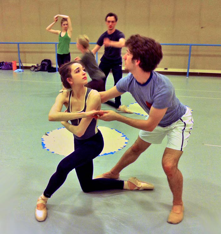 Anthony Sigler as Nijinsky grasps Clara Superfine as Karsavina when she tries to escape at [49] in the reconstructed <I>Jeux</I>, UNCSA, 2013, The <I>port de bras</I> is a quote from Karsavina's duet with Fokine in his <I>Firebird</I> from 1910. © Kenneth Archer. (Click image for larger version)