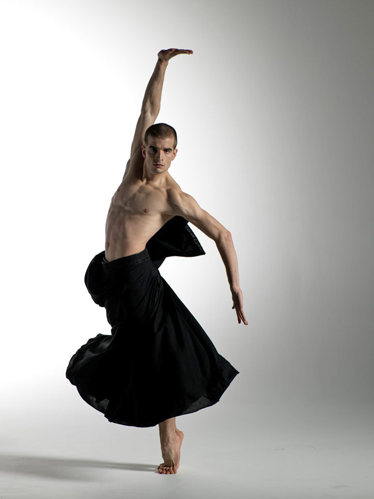 Victor Zarallo in a poster image for Christopher Hampson's Rite of Spring.© G W Shooting. (Click image for larger version)