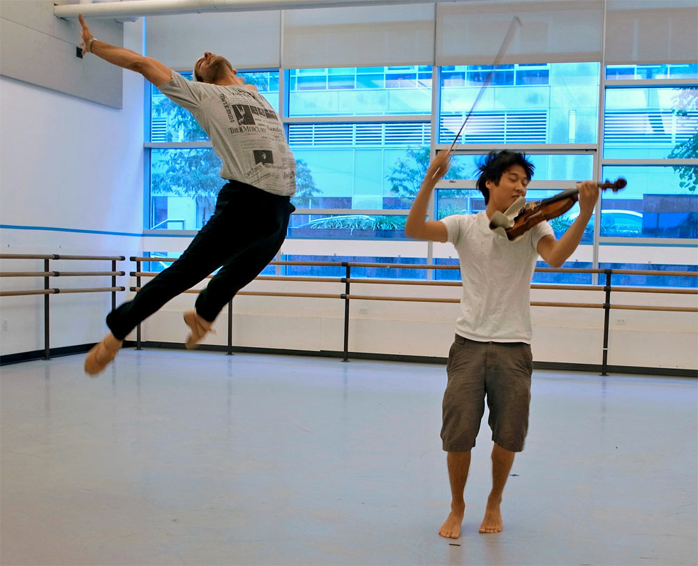 Charles Yang, violinist for the Bach Partita revival, here in the studio with Marcelo Gomes rehearsing Marcelo's solo Paganini.© Ines Laimins. (Click image for larger version)