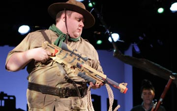 The hunter (Derrick Arthur) and his prey (Daniel Pettrow) in Peter and the Wolf.© Jacklyn Meduga. (Click image for larger version)