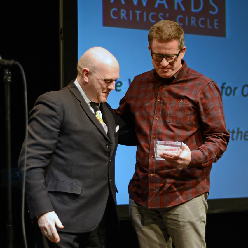 Graham Watts presents the de Valois Achievement award to Matthew Bourne.<br />© Dave Morgan. (Click image for larger version)
