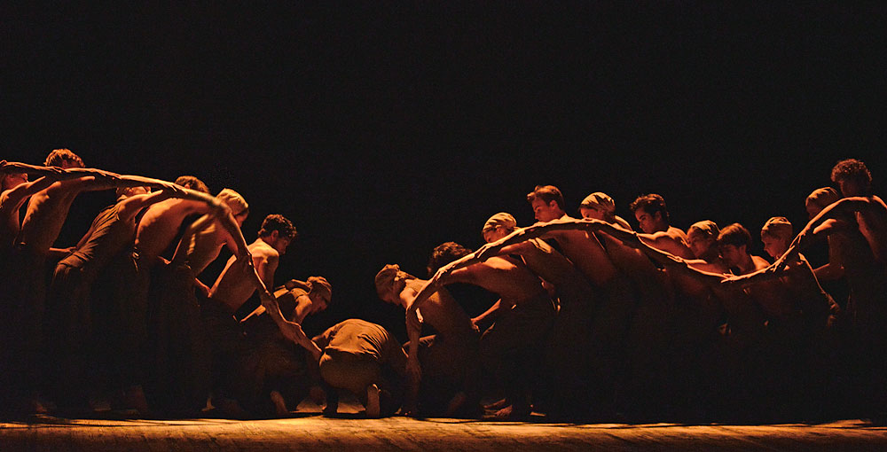 Akram Khan and ENB dancers in Khan's Dust.© Dave Morgan. (Click image for larger version)
