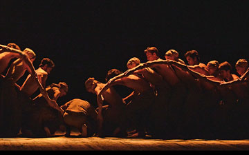 Akram Khan and ENB dancers in Khan's Dust.© Dave Morgan. (Click image for larger version)