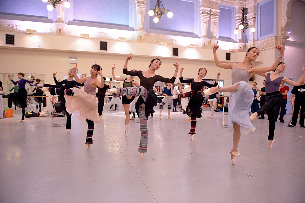 Shiori Kase centre with Artists of the Company rehearsing Coppelia.© Laurent Liotardo, courtesy ENB. (Click image for larger version)
