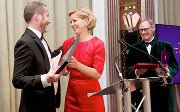 Kevin O'Hare (Director The Royal Ballet) receives the QEII Award from Darcey Bussell (President Royal Academy of Dance) and Luke Rittner (CEO of the Royal Academy of Dance).© Elliott Franks, Royal Academy of Dance . (Click image for larger version)
