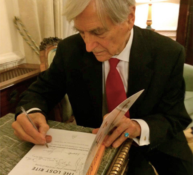 Kenneth Archer signing books at the Polish Embassy launch event on 24th September 2014.<br />© Chris Jones. (Click image for larger version)