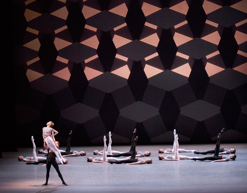 Sterling Hyltin and Andrew Veyette with the company in Justin Peck's <I>Everywhere We Go</I>.<br />© Paul Kolnik. (Click image for larger version)