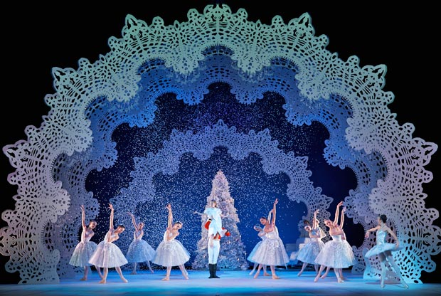 Amy Pollock as Clara, with Remi Andreoni as the Nutcracker Prince, Luciana Ravizzi as the Snow Queen and Company members in Peter Darrell's <I>The Nutcracker</I>.<br />© Andy Ross. (Click image for larger version)