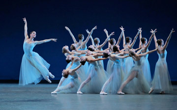 Ashley Bouder and NYCB in George Balanchine's Serenade.© Paul Kolnik. (Click image for larger version)