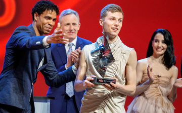 Connor Scott - being presented with his award by Carlos Acosta.© BBC/Guy Levy. (Click image for larger version)