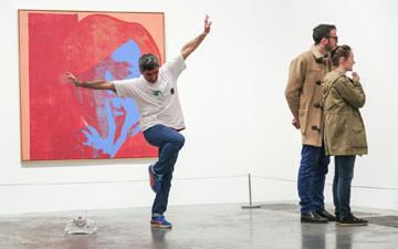 Frédéric Seguette performing part of Jerome Bel's Shirtology.© John Mallinson. (Click image for larger version)