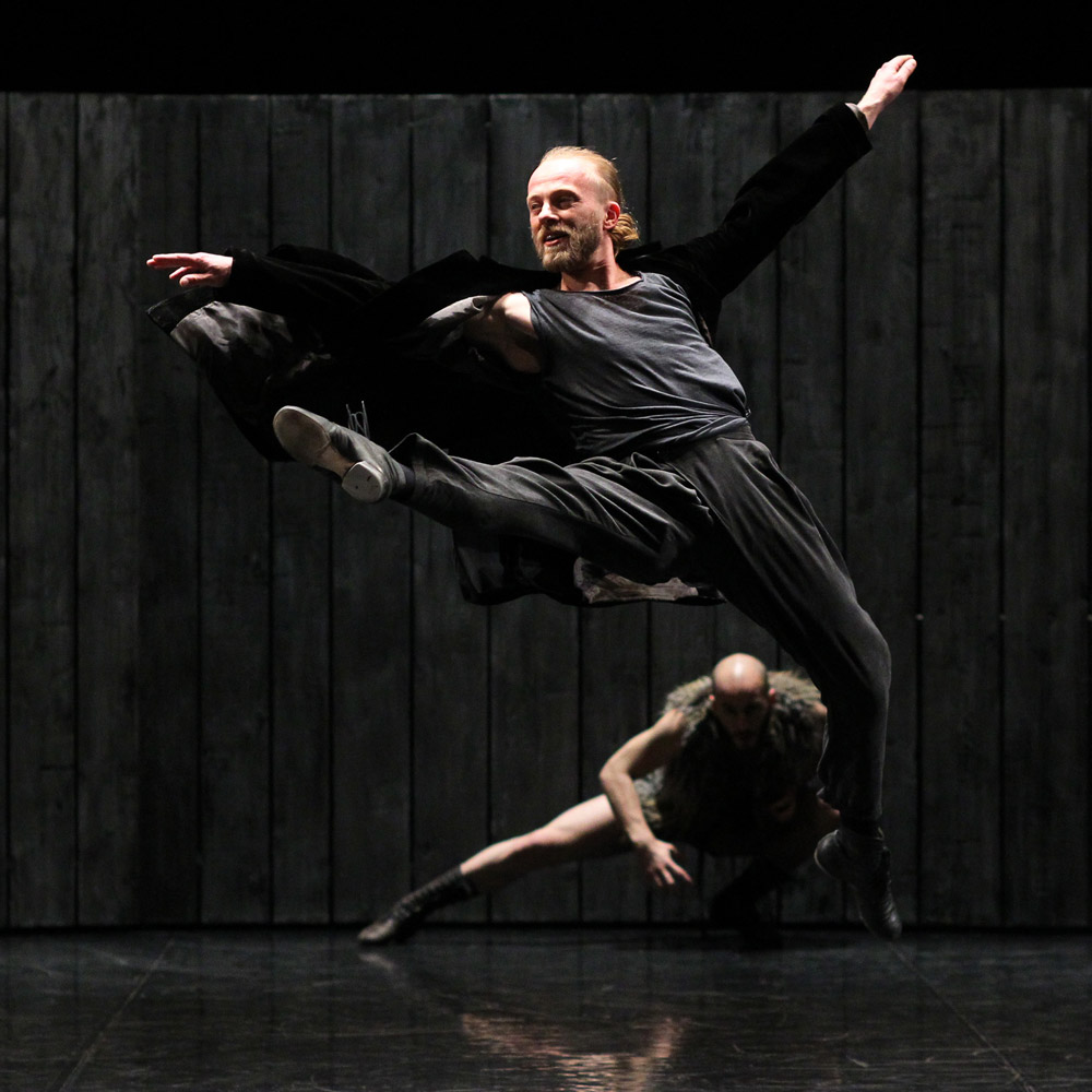 Prospero with Caliban: Filip Michalak and Joel Mesa Gutierrez.<br /><I>The Tempest</I> by Izadora Weiss.<br />© K. Mystkowski. (Click image for larger version)
