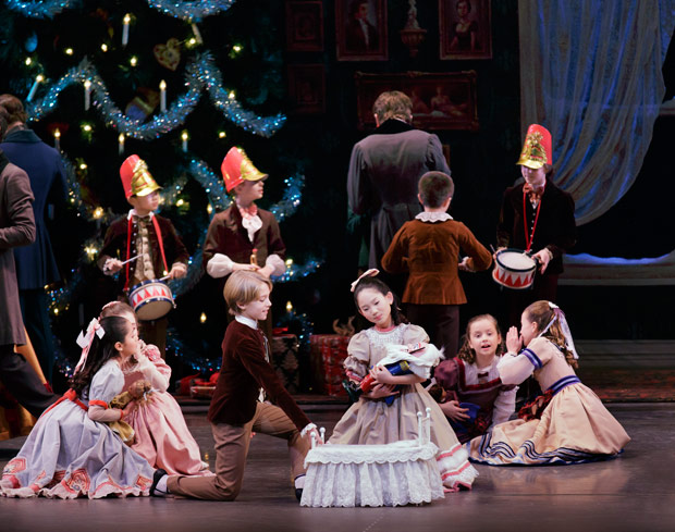 The party scene in Gerorge Balanchine's <I>The Nutcracker</I>.<br />© Paul Kolnik. (Click image for larger version)