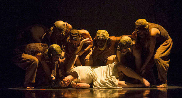 Natalie Trewinnard, surrounded by miners, in Snow White.© Foteini Christofilopoulou. (Click image for larger version)