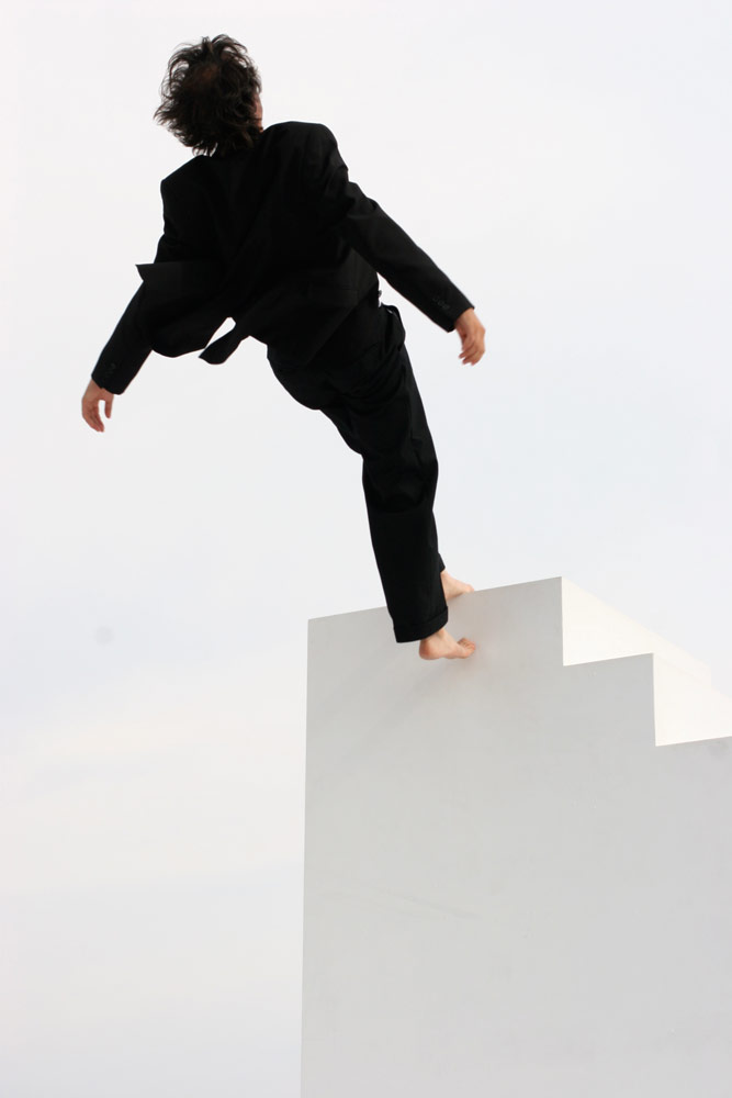 Yoann Bourgeois in the 'Fugue/Trampoline' section of <I>Minuit</I>.<br />© Magali Bazi. (Click image for larger version)