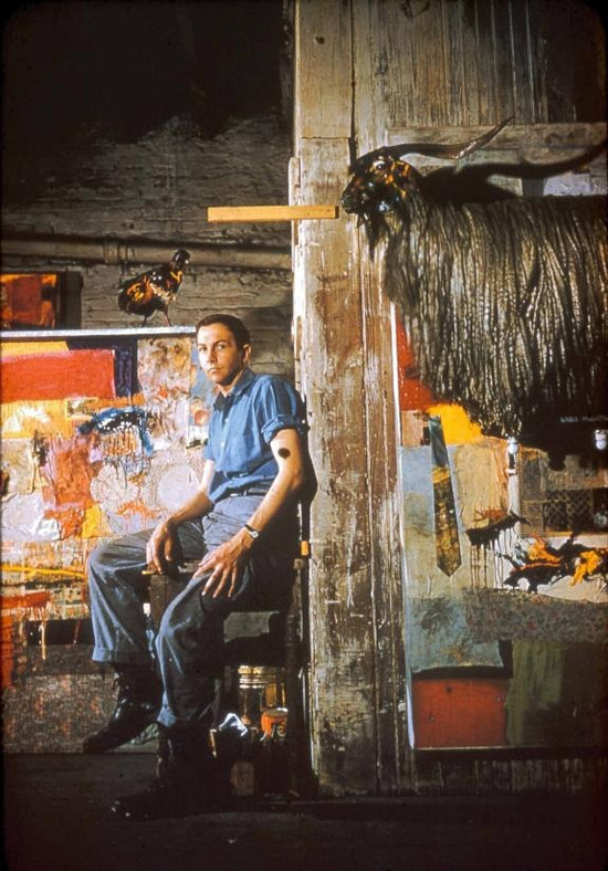 Robert Rauschenberg c1955. Rauschenberg in his Pearl Street studio with Satellite (1955) and the first state of Monogram (1955–59; first state 1955–56), New York.© Robert Rauschenberg Foundation, New York. (Click image for larger version)