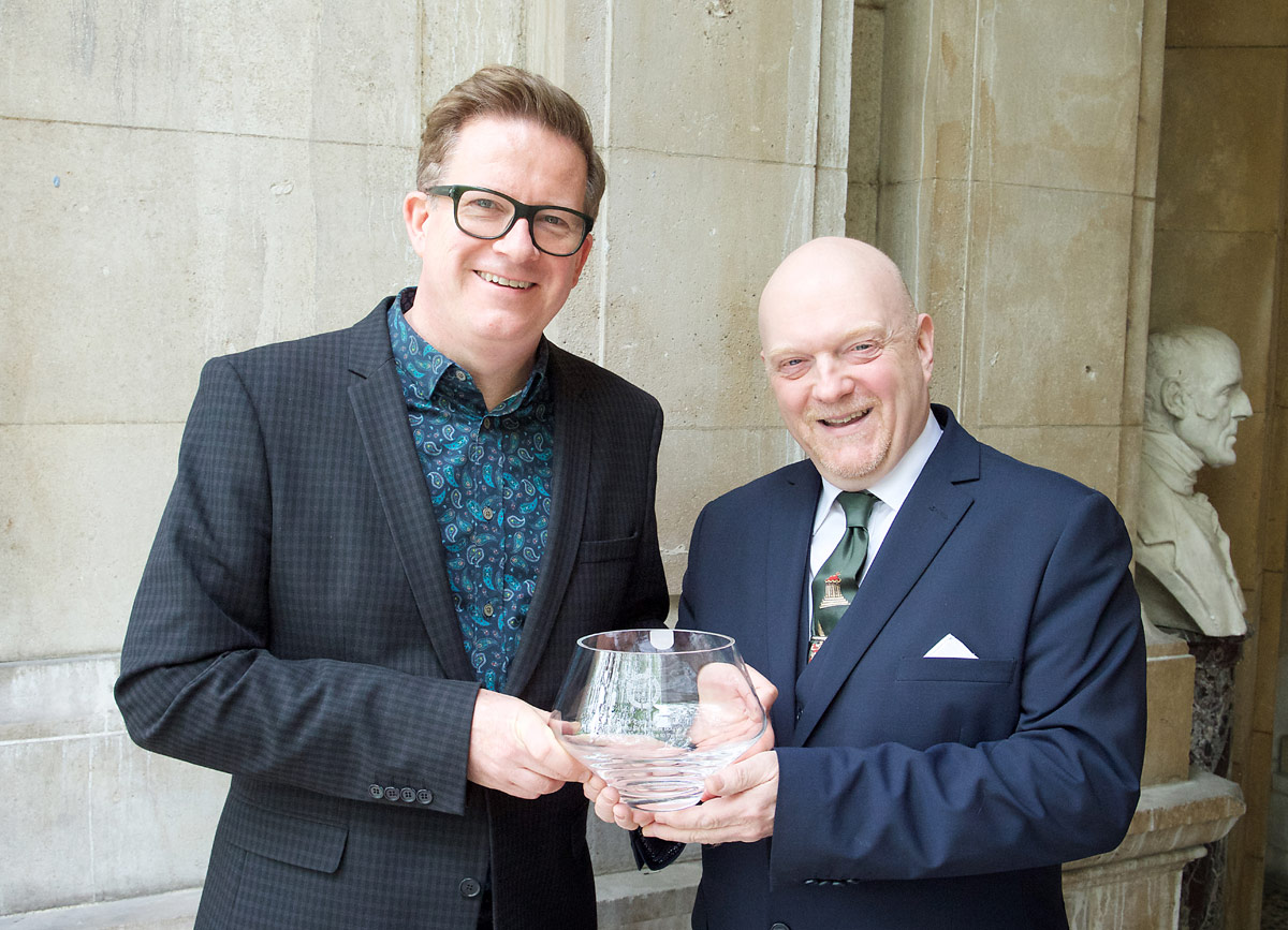 Sir Matthew Bourne and Graham Watts OBE, Chairman, Dance Section of Critics' Circle, together with the Critics' Circle Award for Outstanding Services to the Arts.<br />© Elliott Franks. (Click image for larger version)