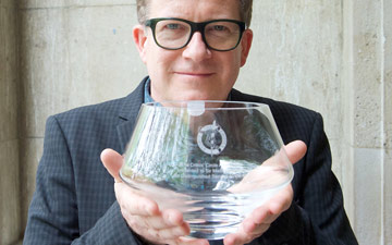Sir Matthew Bourne with the Critics' Circle Award for Outstanding Services to the Arts.© Elliott Franks. (Click image for larger version)