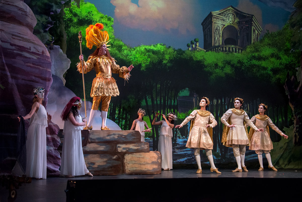 Aaron Sheehan as Apollo with his muses from New York Baroque Dance Company in <I>Le Temple de la Gloire</I> by Rameau.<br />© Frank Wing. (Click image for larger version)