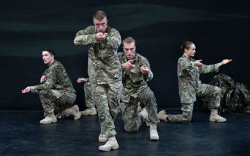 Reece Causton, Oliver Russell, Luke Bradshaw and Harriet Ellis in 5 Soldiers.© Brian Slater. (Click image for larger version)