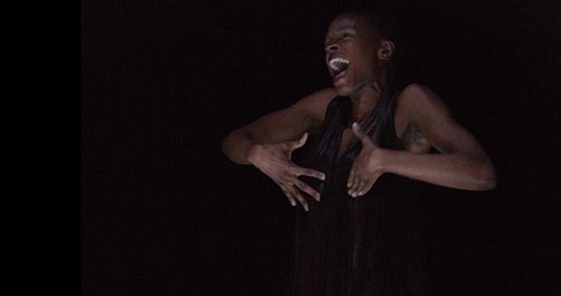 Okwui Okpokwasili in <I>Hunted</I>.<br />© Caroline Ablain. (Click image for larger version)