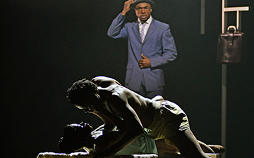 Cira Robinson and Mthuthuzeli November with Jose Alves in Cathy Marston's The Suit.© Dave Morgan. (Click image for larger version)