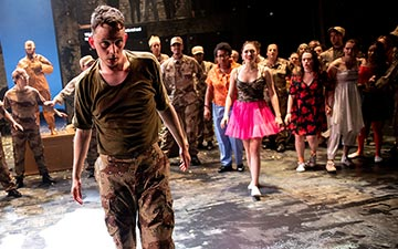 Woyzeck: Thomas Pickles surrounded by the community ensemble.© Graeme Braidwood. (Click image for larger version)
