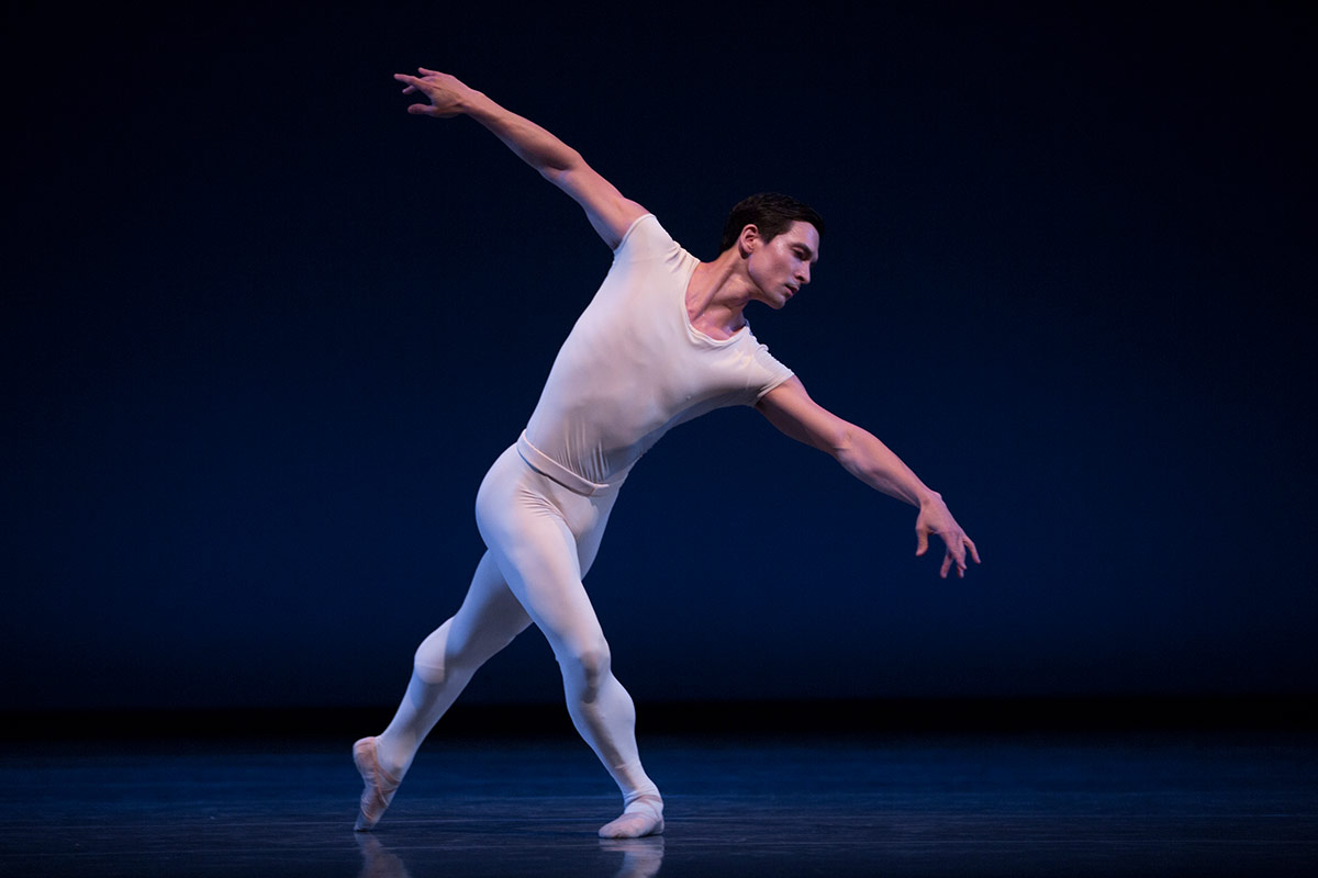 Pacific Northwest Ballet in <I>Opus19/The Dreamer</I>, here with James Moore.<br />© Angela Sterling. (Click image for larger version)