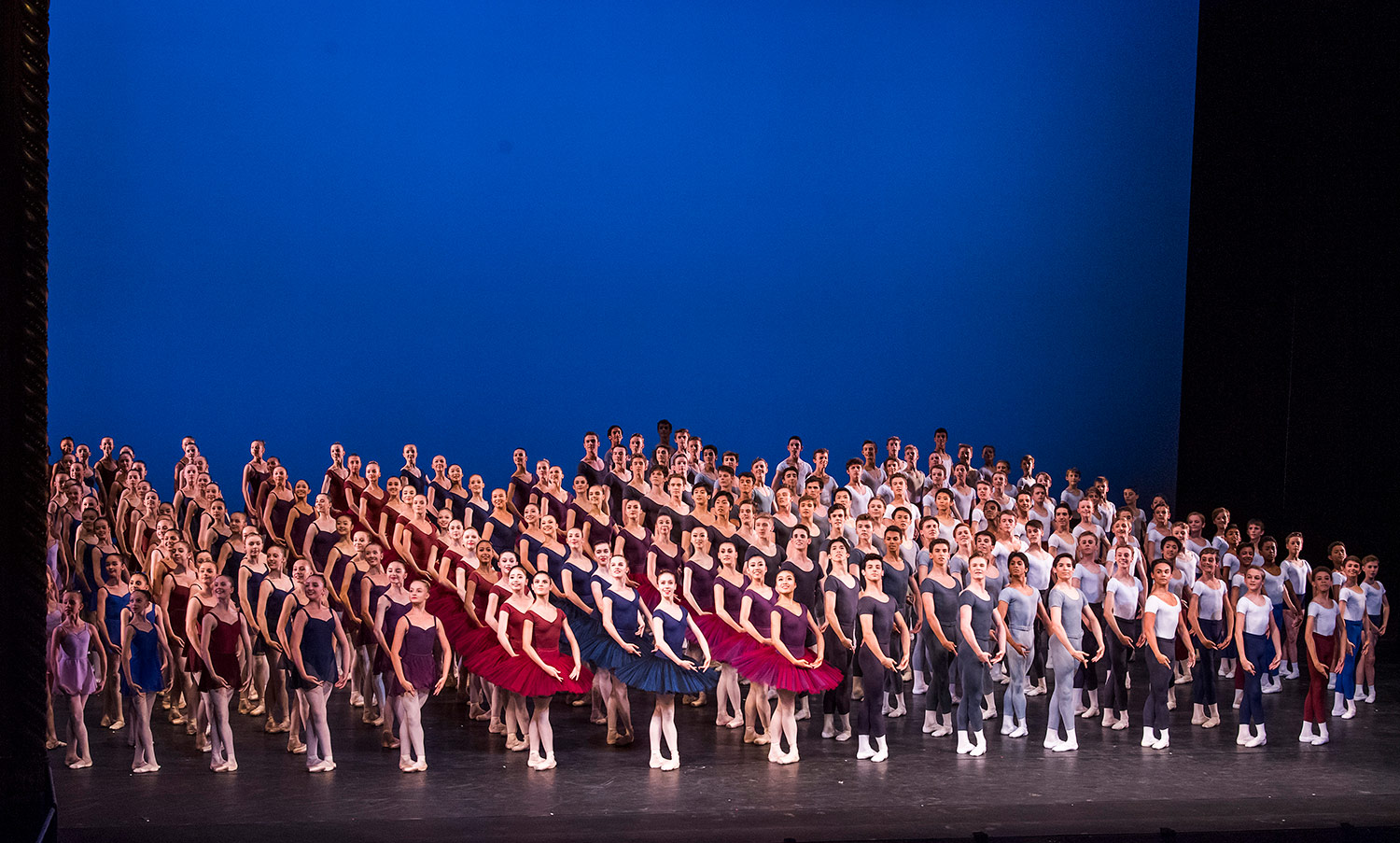 The whole School in the Grand Défilé, conceived by Gailene Stock CBE AM.© Tristram Kenton / Royal Ballet School. (Click image for larger version)