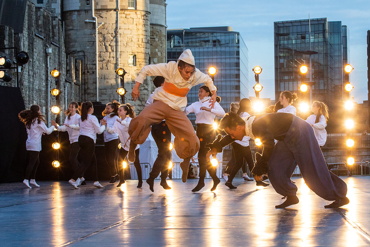 East Wall at the Tower of London - section choreographed by Becky Namguads featuring East Wall Collective dancers Daniel Phung and Mary Mannion and Cando2 Youth Dance Company, Elevate Dance Company and One Youth Dance.© Victor Frankowski. (Click image for larger version)