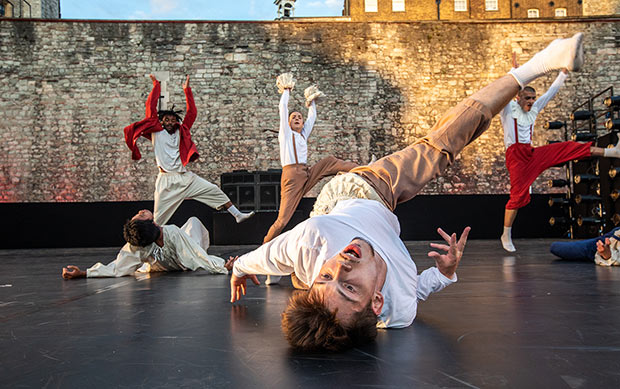 <I>East Wall</I> at the Tower of London - section choreographed by Hofesh Shechter featuring Shechter II dancer Neal Maxwell.<br />© Victor Frankowski. (Click image for larger version)