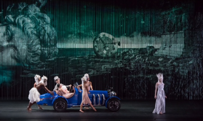 <I>ISADORA: A Tribute to Isadora Duncan in Two Acts</I> with Natalia Osipova as Isadora with Joshua Equia as Paris Singer in car, Emily Anderson as Terpsechore on far right.<br />© Doug Gifford. (Click image for larger version)
