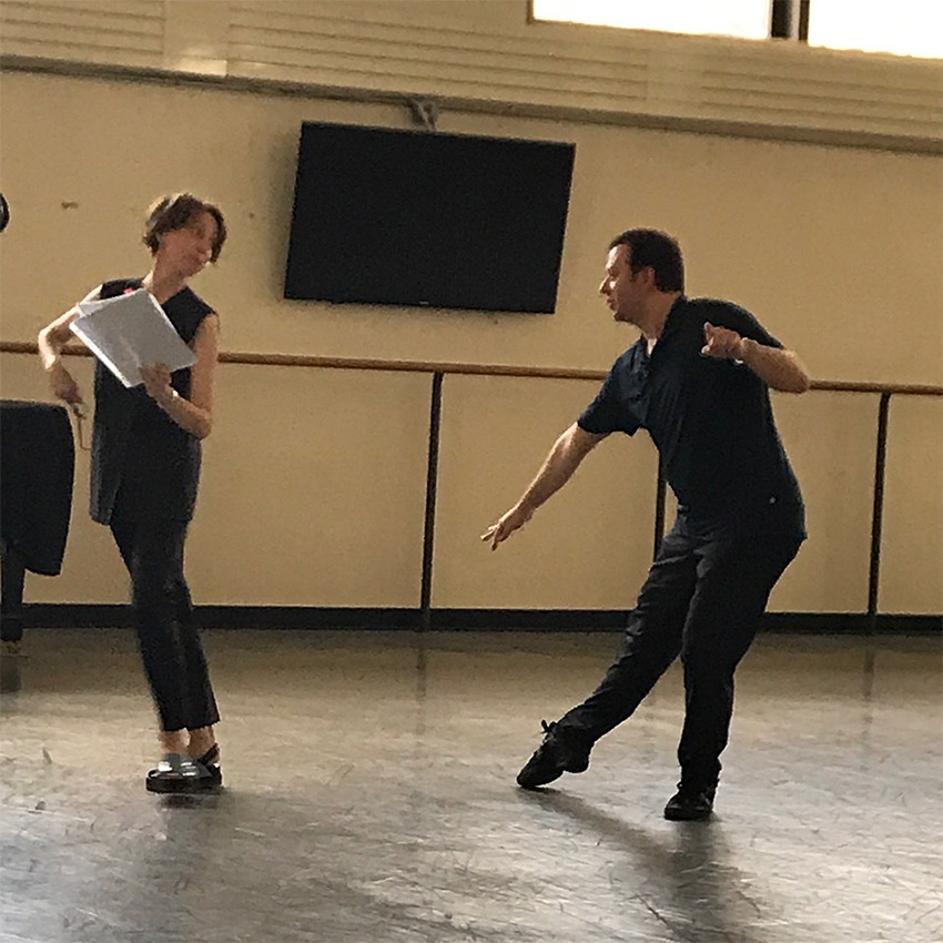 Alexei and Tatiana Ratmansky working out a step from Stepanov notation.© Marina Harss. (Click image for larger version)