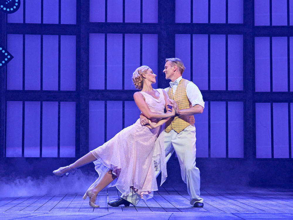 Charlotte Gooch and Adam Cooper in <I>Singin' in the Rain</I>.<br />© Manuel Harlan. (Click image for larger version)